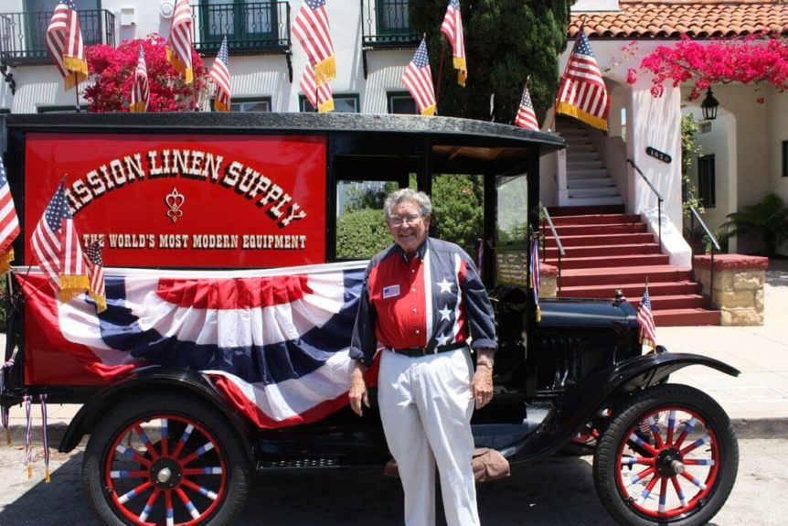 David Taggart with Mission Linen Supply's 1923 Model T Ford at Fourth of July festivities